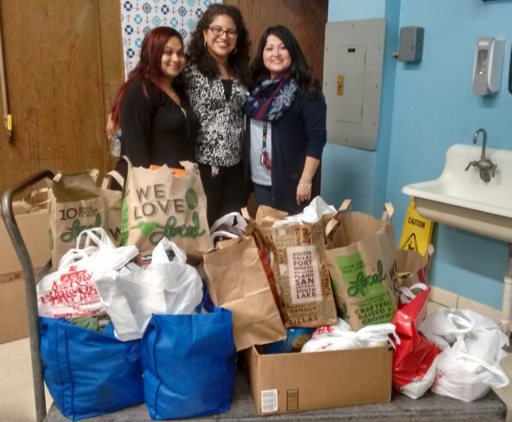 At last Burnet School Alliance meeting, Sarah Martinez (center) brought food donations collected by her son to start a food pantry at Burnet middle school to be managed by Chadima Abrego (left) and Sandra Chavera (right).