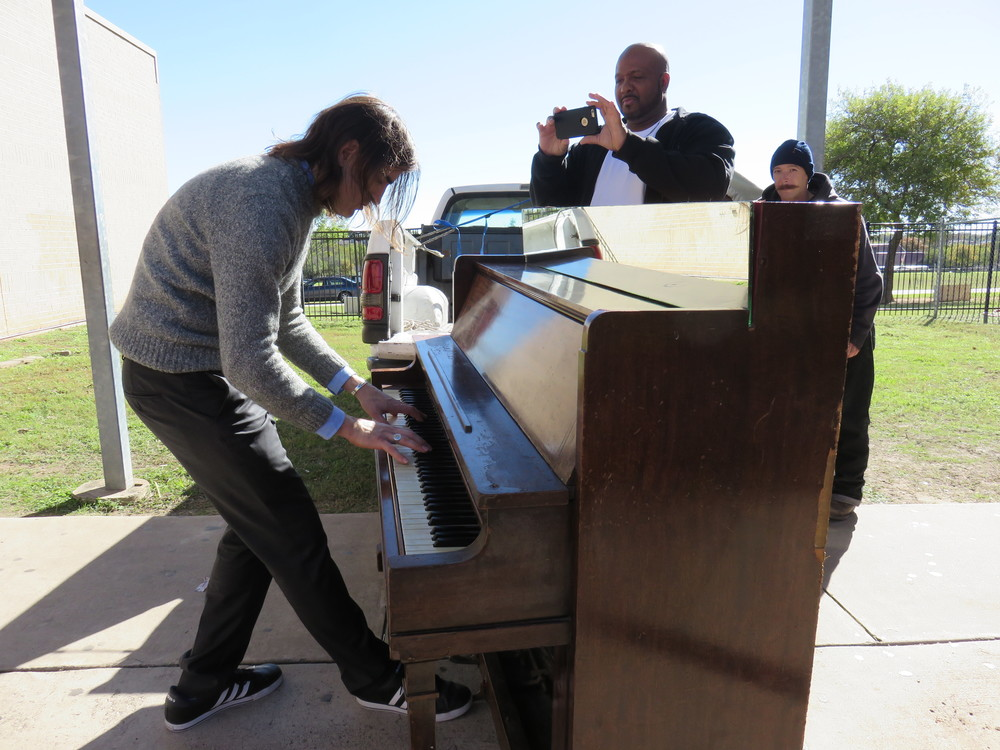 Dobie middle school Orchestra teacher Dallas Shreve played as soon as the piano destined for the school was unloaded.