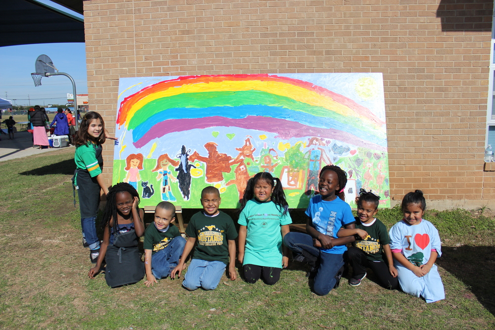 Representing children playing under a rainbow, the mural was designed to send the message to keep Barrington park (that is shared with the community) beautiful. It will be hung on the school's fence in the upcoming weeks.