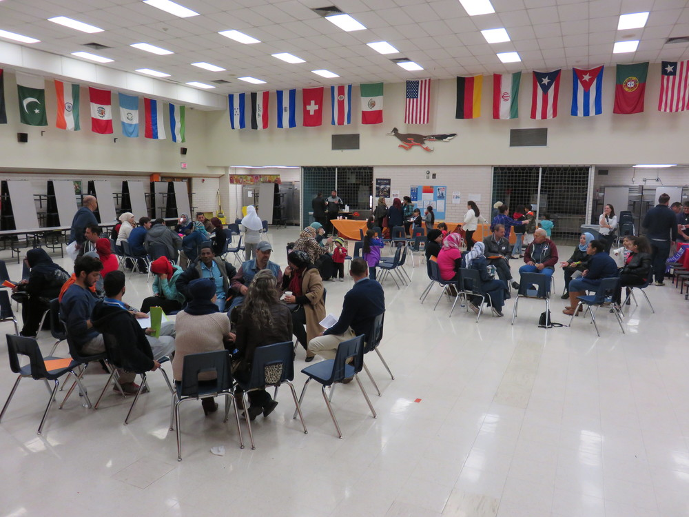 Arabic-speaking families gathered in Dobie Middle School cafeteria, where a breakfast was offered prior to the meeting, from 10:30am on Saturday. Volunteer University of Texas Arabic language students translated to and from Arabic for each group of parents.
