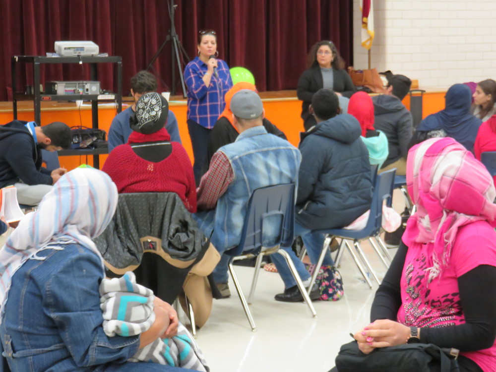 Different speakers concluded the event. Here, Dobie Middle School principal Maggie Raujo (right) translated by English/Arabic Austin ISD Parent Support Coordinator Ban Al-Baghdadi (center).