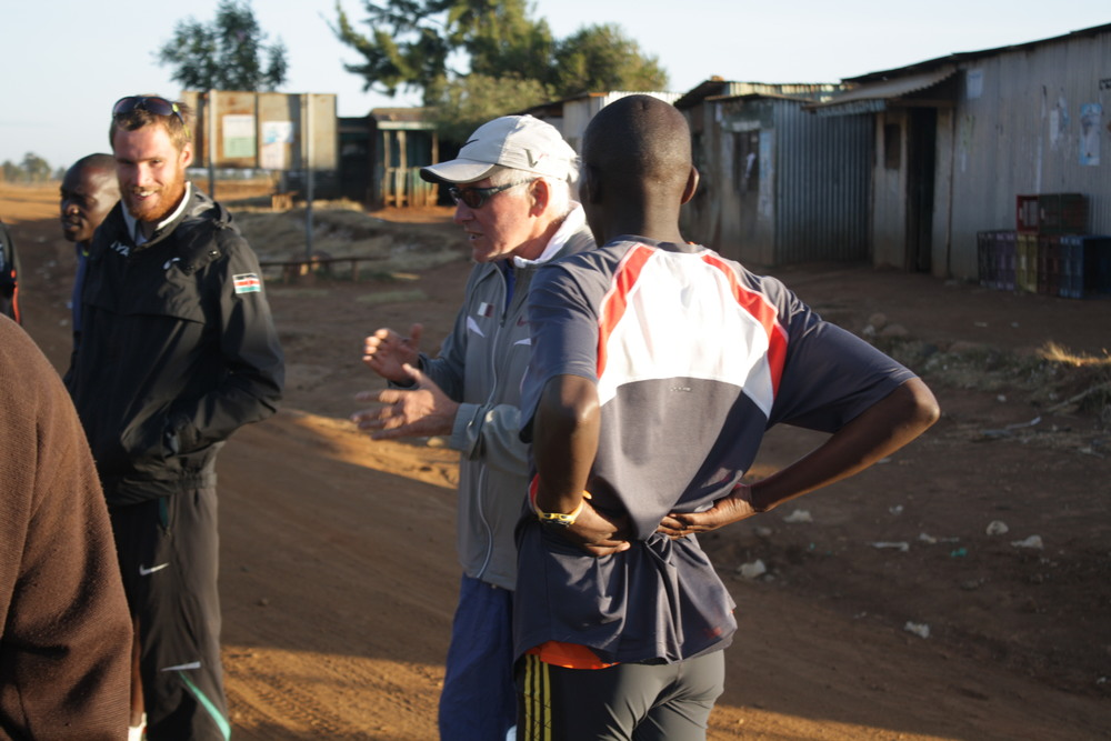 Renato Canova (center) talks with his athletes in Kenya before assigning a lactate dynamics workout