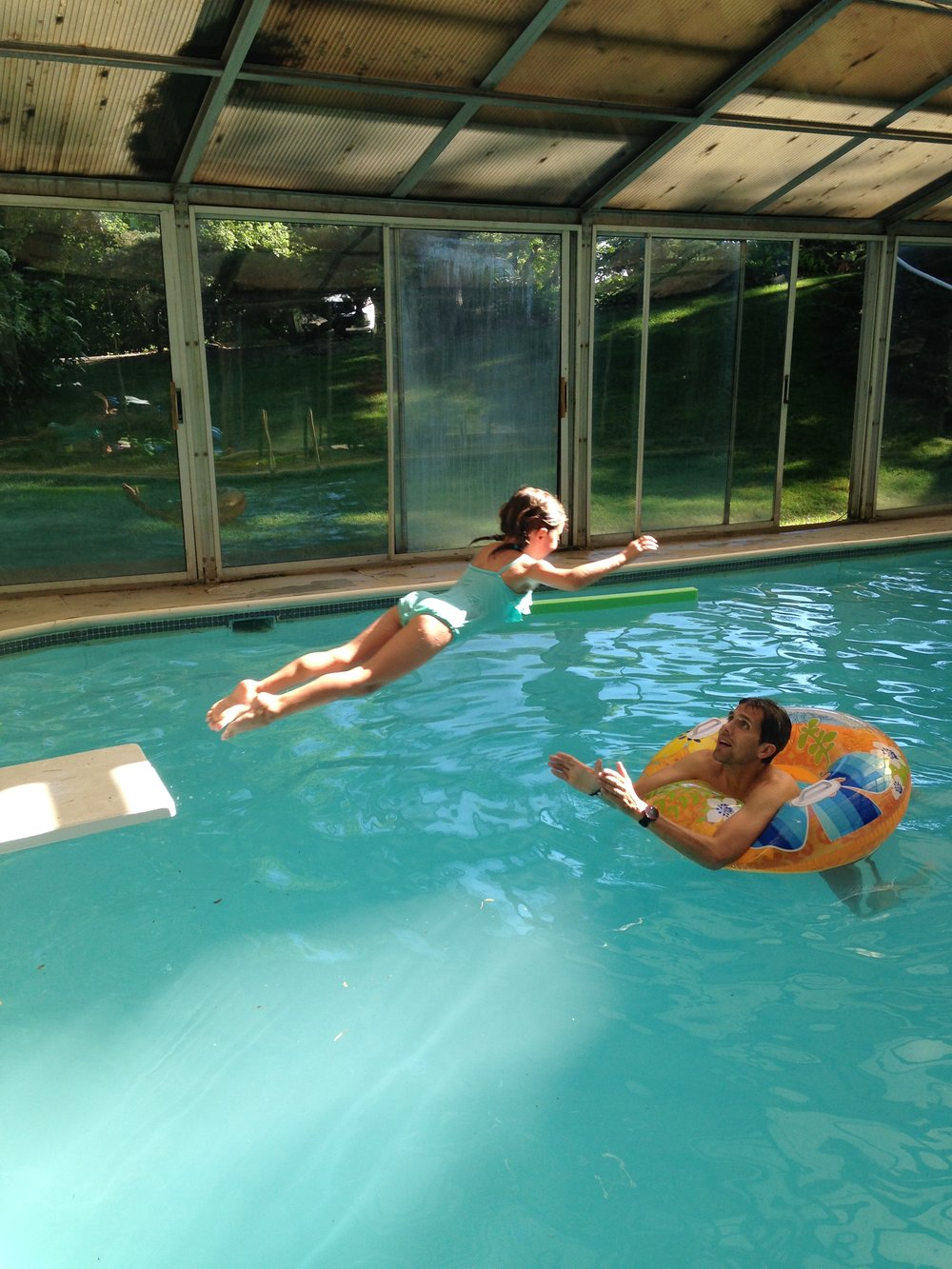 My oldest daughter leaping to me in the much-beloved indoor pool (photo courtesy Mark Latter)