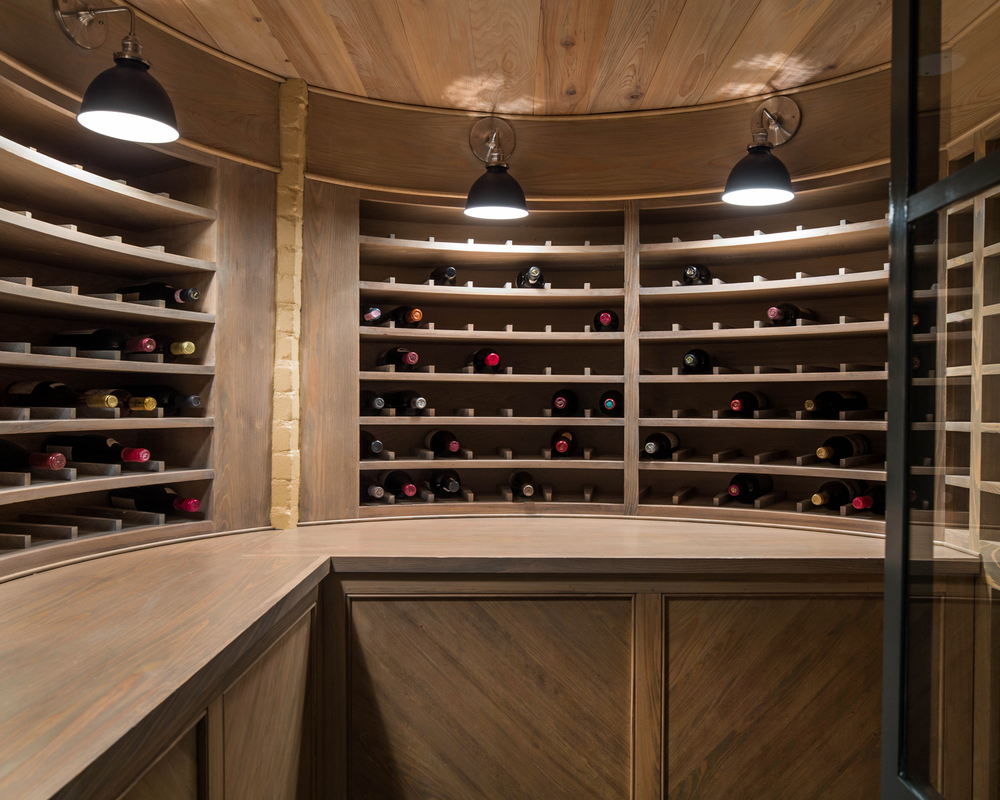 Walk-in wine cellar with cyprus paneling, steel/glass door, and stand alone climate control.