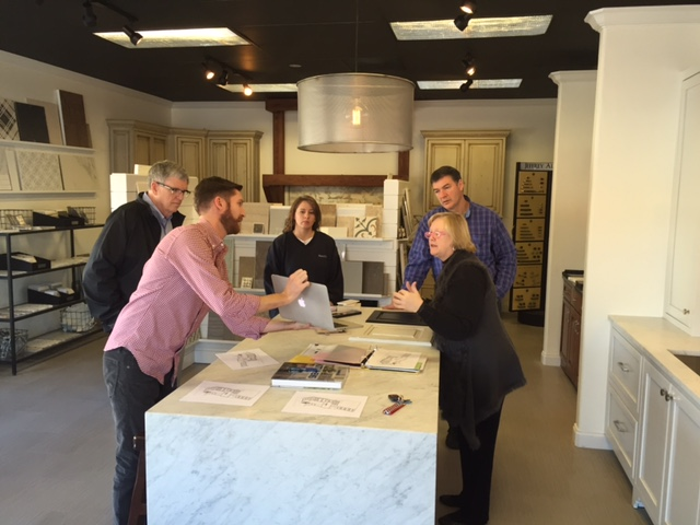 Client orientation at needco Cabinet's homewood, Al SHOWROOM
