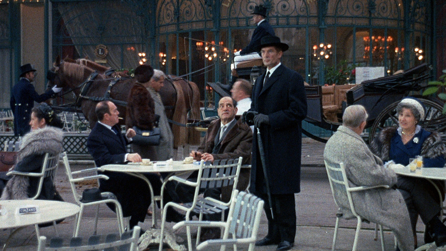 Buñuel (centre) appears in a cameo as a man at a bar in Belle de jour