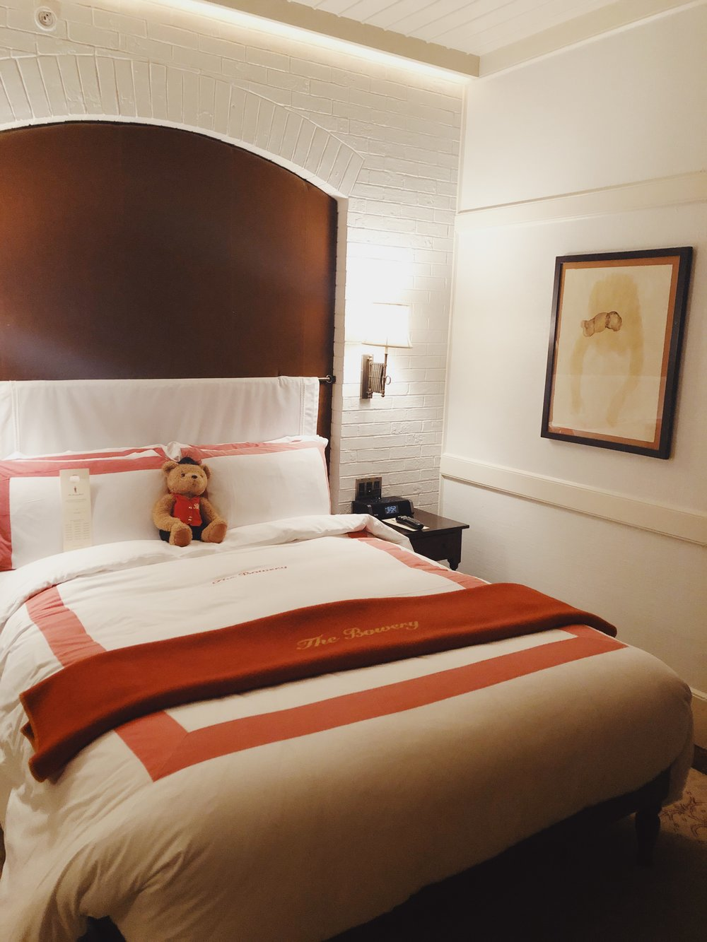 the bowery hotel bed with bear