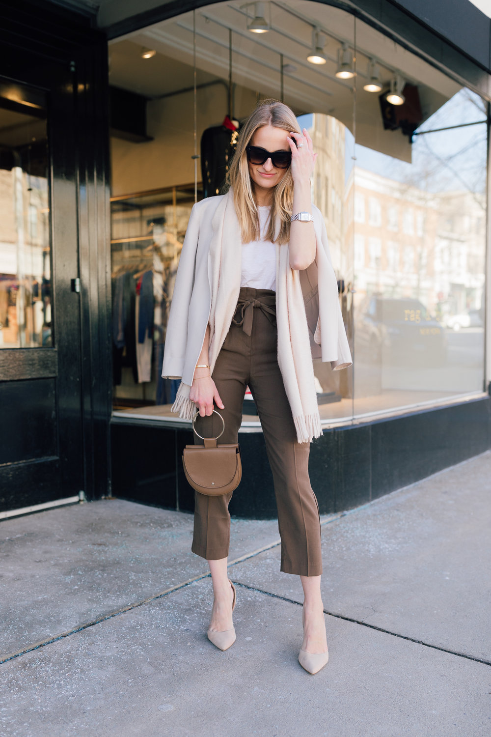 Stephanie Trotta of The Girl Guide wearing a paper bag pant street style for work wear with a neutral blazer and scarf