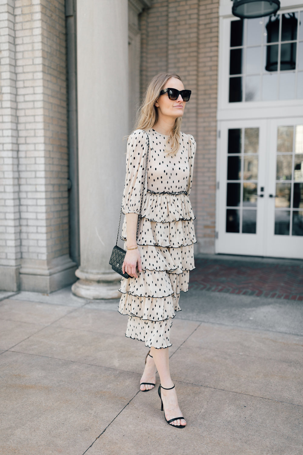 Style a Ganni polka dot ruffle dress // Chanel WOC black bag // Celine Catherine Sunglasses // Dress styled with leather jacket // Stephanie Trotta // The Girl Guide
