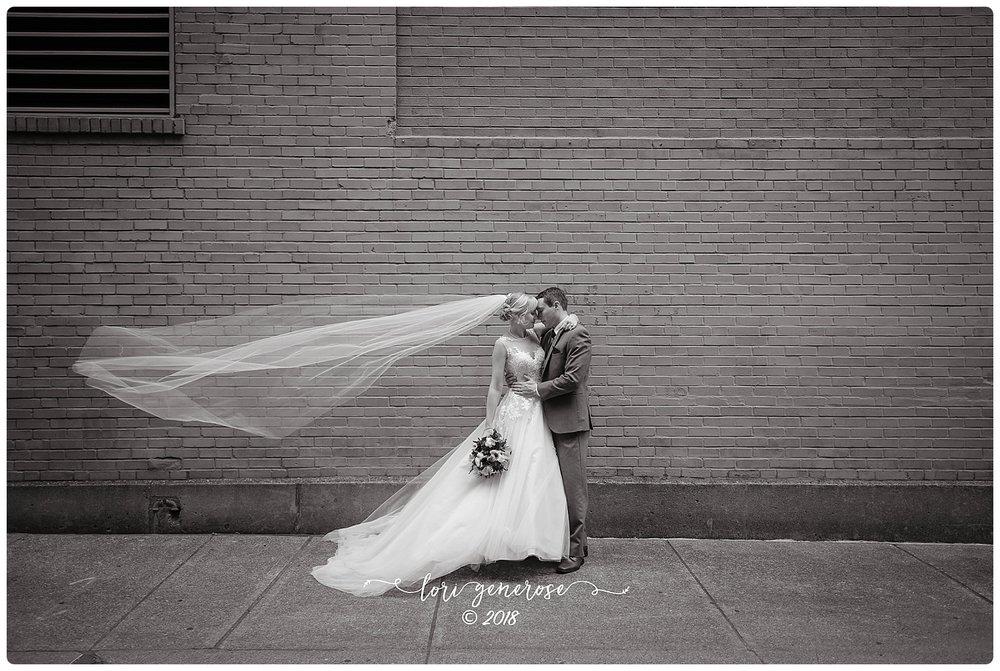lgphotographylorigenerosetheinnatpoconomanorpaweddingvenuebridegroombankstreetalleyeastonpa.jpg