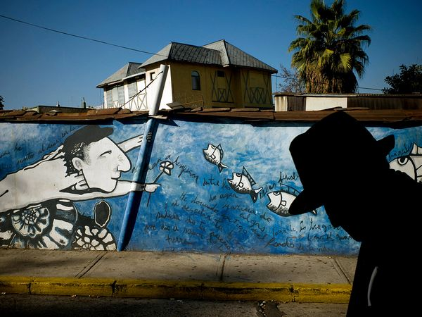 Mural of Neruda graces the Bellavista neighborhood in Santiago, Chile.                                               Photograph by Tomas Munita, The New York Times/Redux