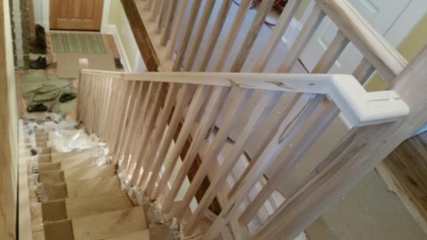 "1-3/4 x 2-3/4"" Wormy Maple standard railing, 3-1/2 Chamfered Contemporary Post, 1-5/16 Chamfered Wormy Maple spindles.  Job Location: Toronto, Ontario"