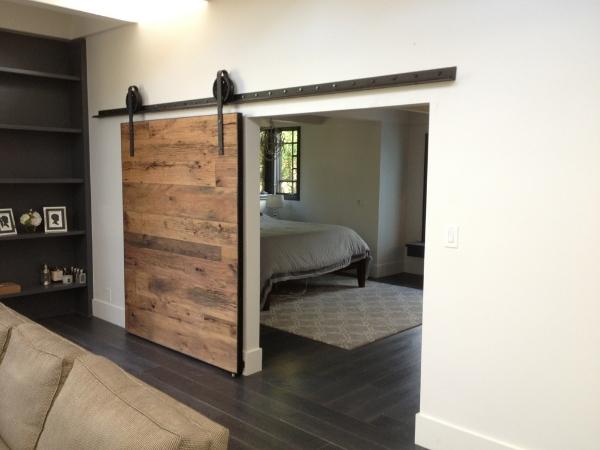 cool-barn-door-track-system-and-black-wood-floor-idea-feat-contemporary-rectangular-bedroom-rug-design.jpg