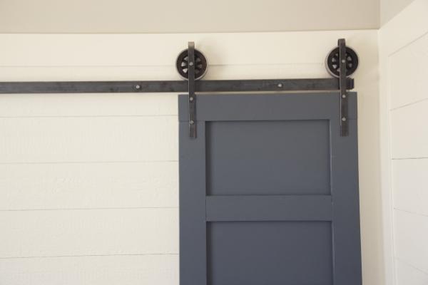interior-designs-accessories-furniture-astounding-hafele-barn-door-hardware-with-black-iron-sliding-door-on-combined-grey-wooden-door-and-stunning-white-wooden-panels-wall-modern-hafele-barn-do.jpg
