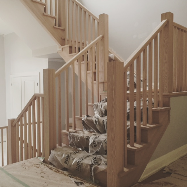"4-1/2 plain square posts, standard railing, 1-5/16"" square oak spindles.  Job Location: Horseshoe Valley, ON"