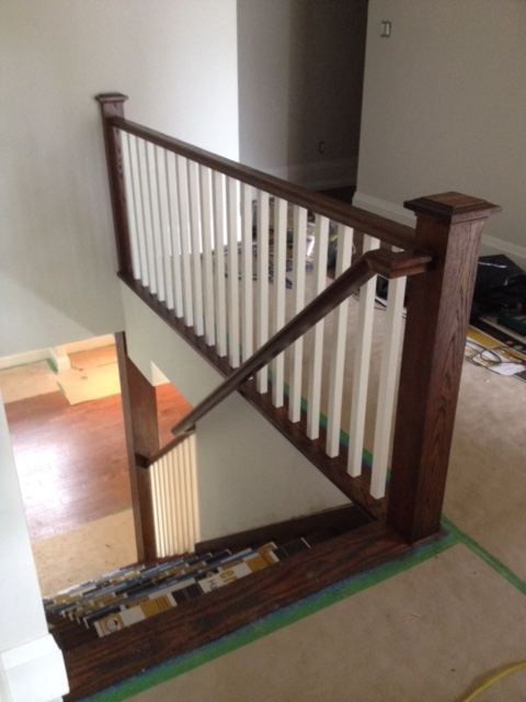 4-1/2 post with cap, standard railing, 1-5/16 poplar spindles. We also capped the steel jack post in the basement with oak.  Job Location: Snow Valley, ON