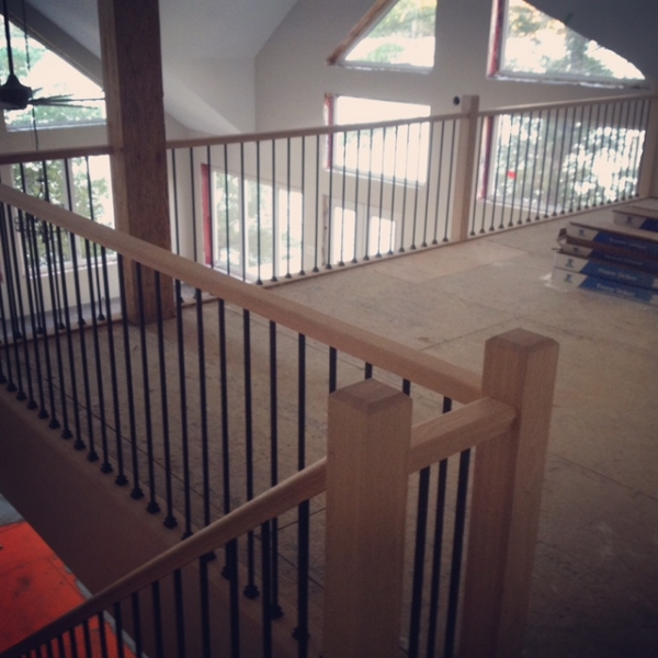 Standard Oak Railing, 3-1/2 Oak Contemporary Post, Plain TL12-40 Wrinkled Black Spindles.  Job Location: Parry Sound, ON