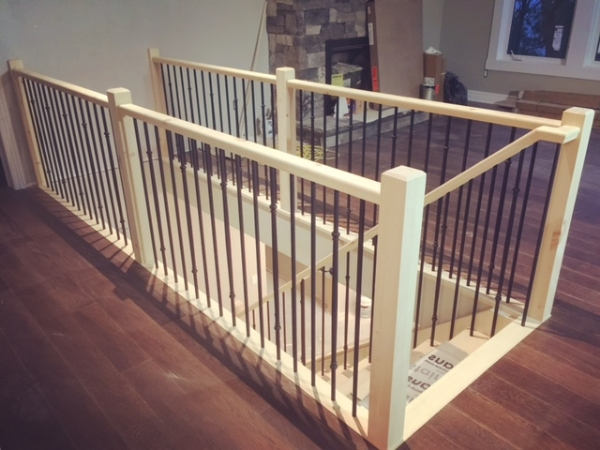 "3-1/2 Contemporary Pine posts, standard pine railing, TL58RD-30 & TL415RD-30 satin black (5/8"") tubular spindles.  Job Location: Parry Sound, ON"