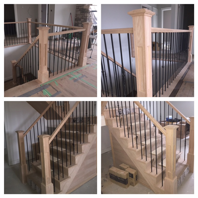 4-1/2 Recessed panelled posts with base, standard oak railing, TL261-1-40 & TL261-4-40 Bezdan steel spindles. Job Location: Oro, Ontario