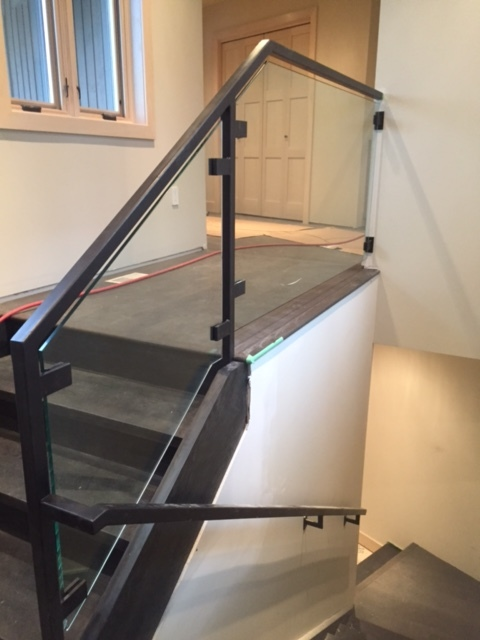 Stairs & Railings by Stairhaus. Custom square tubular steel railings with custom square glass clips. Job Location: Blue Mountain, ON