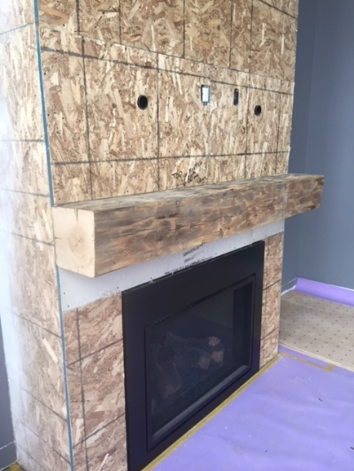 10x10 Elm barn beam mantle. We supplied and installed this beam. Job location: Beeton, ON — in  Beeton, Ontario .