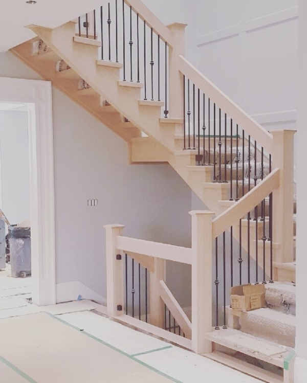 Stairs and railings supplied and installed by Stairhaus. 2x5-1/2 vertical railing, 5-1/2 square oak posts with cap, TL12-40 & TL130-1-40 wrinkled black spindles. The main floor and 2nd floor posts will have glass clips installed for the 12mm clear tempered glass guards.  Job Location: Toronto, ON