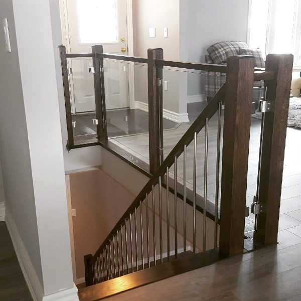 "3-1/2 Contemporary post, 1-1/2"" x 2-1/8"" contemporary railing, TL58-SS stainless steel spindles, 10mm clear tempered glass with stainless steel glass clips.  Job location: Flesherton, ON"