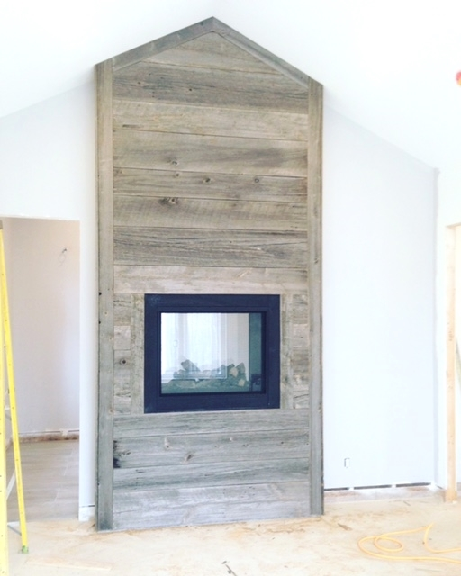 "1"" grey board installed around a fireplace."