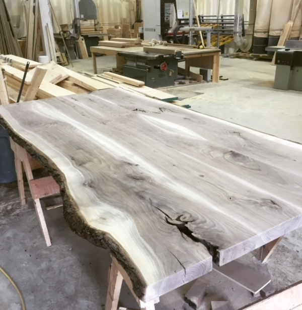 "2"" live edge walnut slabs laminated together for a harvest table top.  We glued up 5 slabs to get this top to the right size (52"" x 104"")"