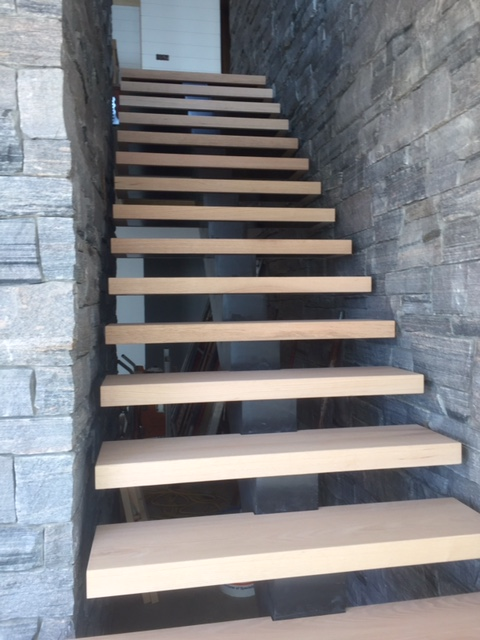 "Steel mono-stringer with 2-1/8"" red oak treads.  Job location: Gravenhurst, ON"