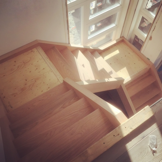 "Double self support stairs with built in landings.  Stairs are closed 2 sides with 1-3/4"" oak treads.  Job location: Horseshoe Valley, ON"