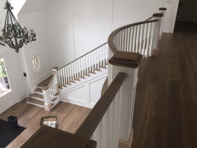 "7-1/2"" paint grade recessed paneled posts with bases/caps, 1-3/4 x 3"" white oak railing with 1-3/4"" paint grade poplar spindles.  Job location: Innisfil, ON"