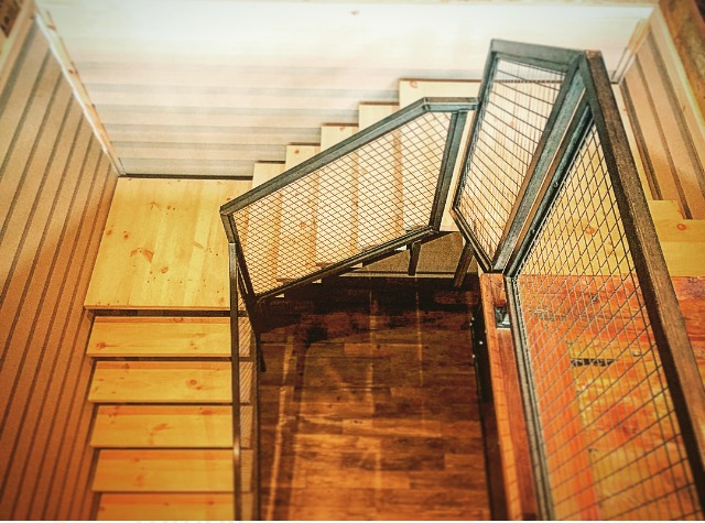 "Steel self support stairs with 2-1/8"" pine treads/landing slabs. We had tubular steel railings with mesh panels installed for the rail system.     Job location: Muskoka, ON"