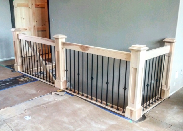 Hickory stairs & railings supplied by Stairhaus. 5-1/2 shaker hickory posts with bases, 1-3/4 x 4-1/2 hickory vertical railing with TL12-40 & TL130-1-40 wrinkled black spindles.  Job location: Fergusonvale