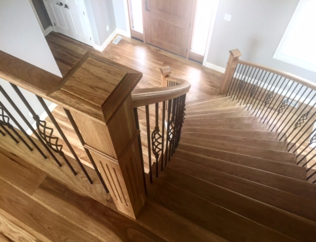 4-1/2 hickory fluted posts with caps, standard hickory railing with TL15-40 & TL103-1-40 wrinkled black spindles.  Job location: Blue Mountain, ON