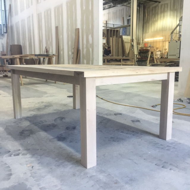 Custom reclaimed maple harvest table.  Material was supplied by customer.  This table had bread board ends.