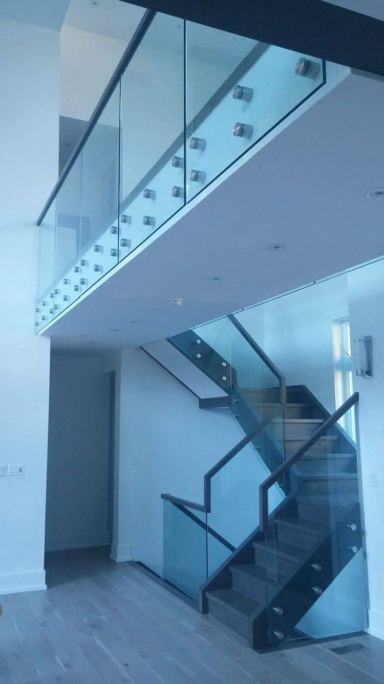 "Stairs and railings/glass supplied & installed by Stairhaus. Closed rise, 1-3/4"" treads with built in self support landings with 12mm clear tempered glass supported by 2"" stainless steel standoff's.  Job location: Horseshoe Valley, ON."
