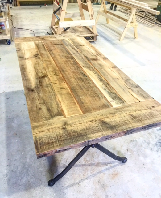 "We don't get into a lot of tables anymore due to our stair/railing workload. It is always nice to switch it up once in a while however. Here is a reclaimed pine/fir table our custom shop guru Leland whipped up for a customer last week. This table has a fir ""stripe"" down the middle and is outfitted with breadboards. Legs were supplied by our customer."