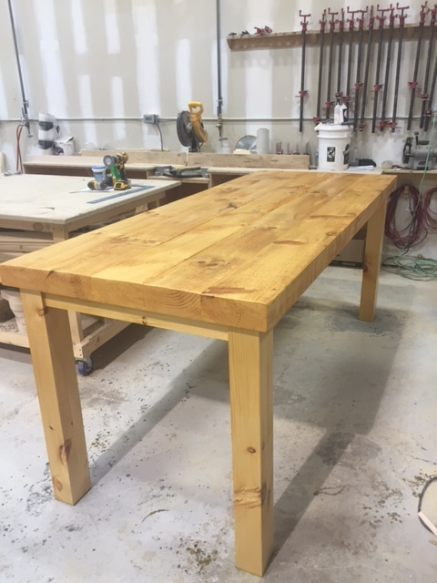 2-3/4 solid pine top with rectangular pine legs.  We built 2 of these harvest tables just in time for Thanksgiving!