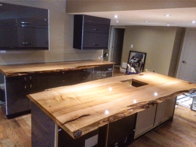Here are 2 maple live edge slabs that we turned into countertops. These slabs have a polyester sealant which gives them an epoxy look-a-like finish. This bar is now ready for a party!  Job location: Barrie, ON.