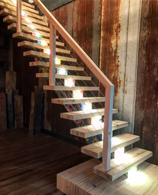 After countless hours off the clock, our main showroom stair is complete. This urban/modern showpiece hopefully helps people think outside of the box. We like to do things differently and we constantly challenge ourselves to one-up our stair game daily. This stair has many elements - reclaimed elm, reclaimed hemlock, steel, LED lights, infinity landing, mono-stringer and a square infinity style railing/post system. Like it or hate it, I hope this shows you that stairs can be a piece of art instead of just a means to go up and down.  Job location: The Haus, Barrie, ON.