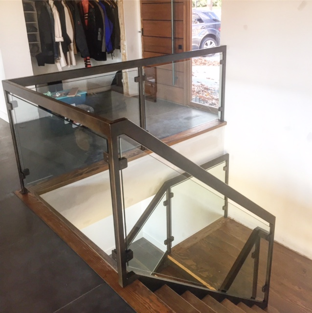 We had steel stairs & railings fabricated for this modern project. The treads were made out of fir and clad the steel tread pans. The railing and posts are tubular steel with a custom paint job. We used 12mm clear tempered glass with our standard square glass clips. It was great to work with @carolineharrisondesigns on this project!  Job location: Barrie, ON