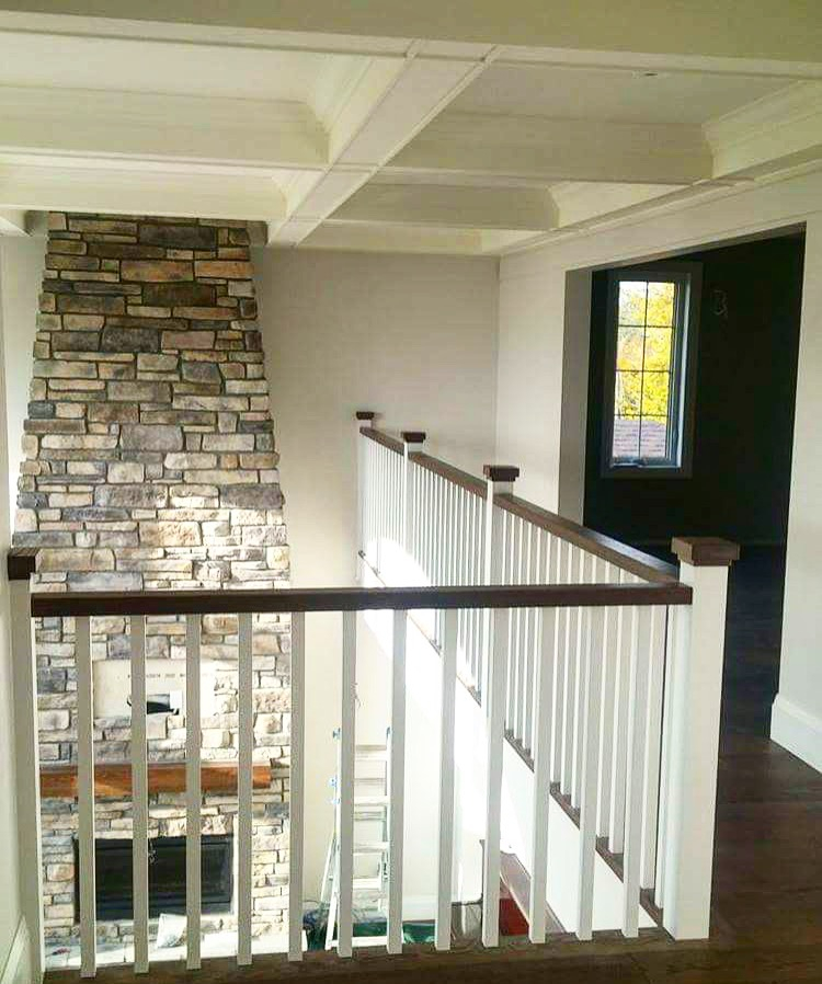 1-1/2 x 2-3/4 flat oak railing, 3-1/2 paint grade posts with layered square oak caps & 1-5/16 paint grade square spindles.  Job location: Barrie, ON.
