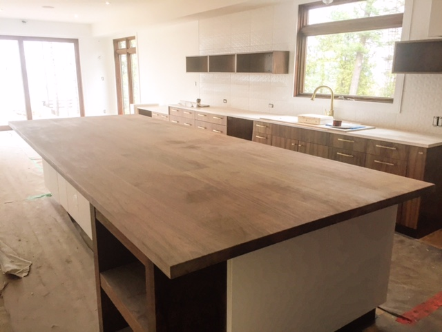 "Massive walnut island slab we built last week. This monster weighed in close to 600lbs (1-3/4"" x 5' x 14'). Every butt joint piece was joint fastened, going to look deadly when sealed.  Job location: Wasaga Beach, ON"