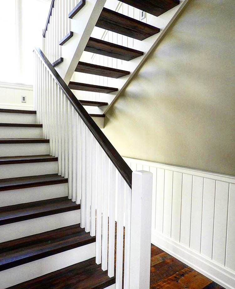 Stairs and railings supplied and installed by Stairhaus. We have a mix of open rise and closed rise stairs in this house. The treads are 1-3/4 white oak (skip dressed) with paint grade risers and stringers. We used our paint grade contemporary posts, 1-5/16 square poplar spindles and an oversized white oak railing.  Job location: Creemore, ON.