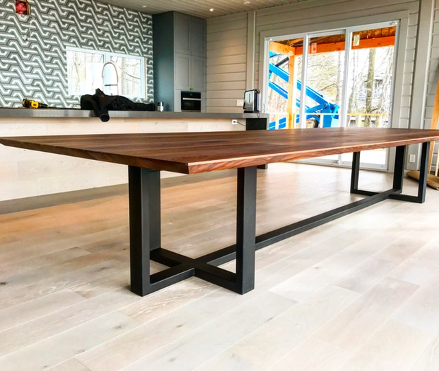"5x15 Infinity Walnut dinner table with custom steel base. The top alone weighs in around 700lbs - it took 6 of us to carry it into the house. The edge is beveled to give it an infinity look (the slab is 1-3/4"" solid). Job location: Tiny Beaches, ON"
