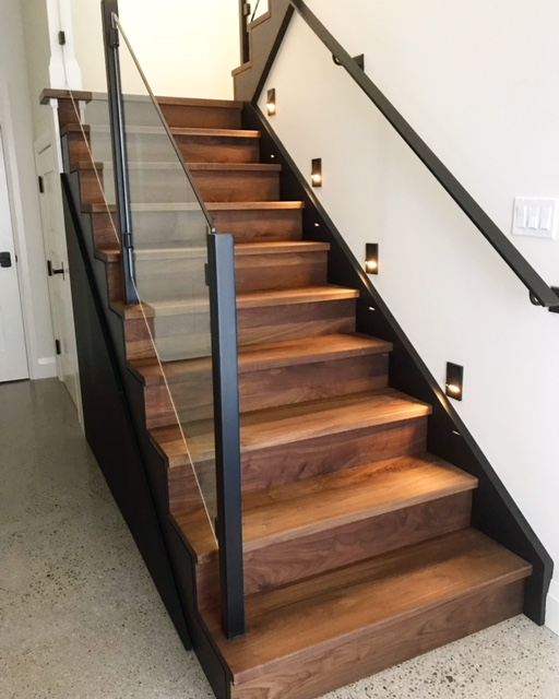 "Infinity walnut stair with custom 1/4"" walnut reveals on open side.  Job location: Muskoka, ON"