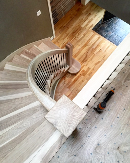 Open 1 side hickory circular stair with standard railing & plain posts.  Job location: Midhurst, ON