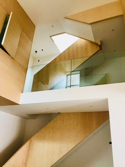 Infinity stair with built-in stain grade guard walls.  This is as modern as it gets!  Job location: Toronto, ON