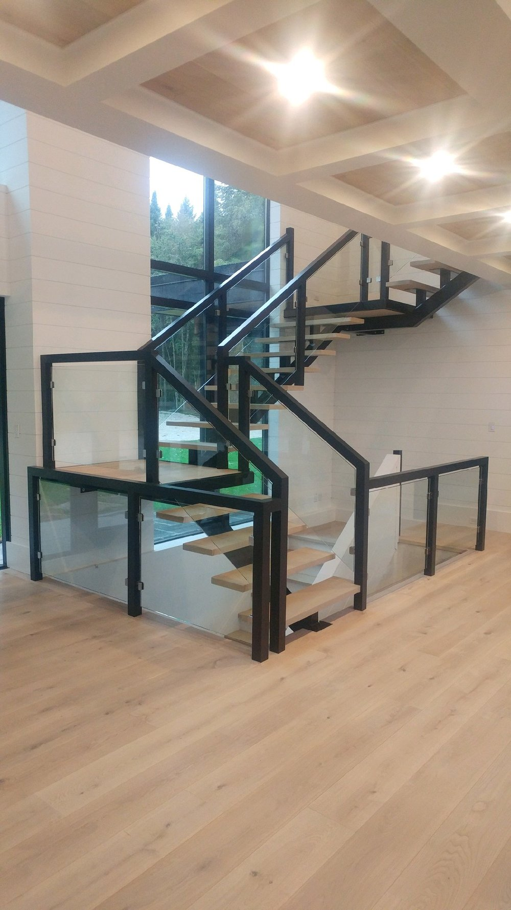 """2-3/4"""" x 2-3/4"""" paint grade infinity post/railing system with 10mm clear tempered glass.  Job location: Innisfil, ON."""